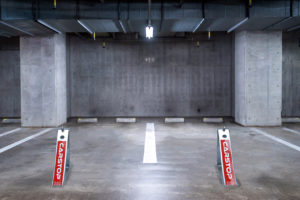 Carstop parking barriers in use in an under cover garage