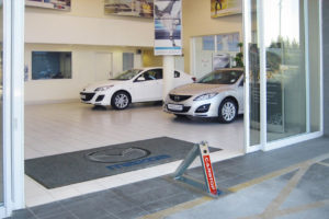 Car showroom with Carstop parking barries in use