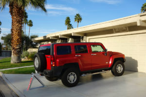 Red Hummer Parked in driveway with Carstop parking barriers in use